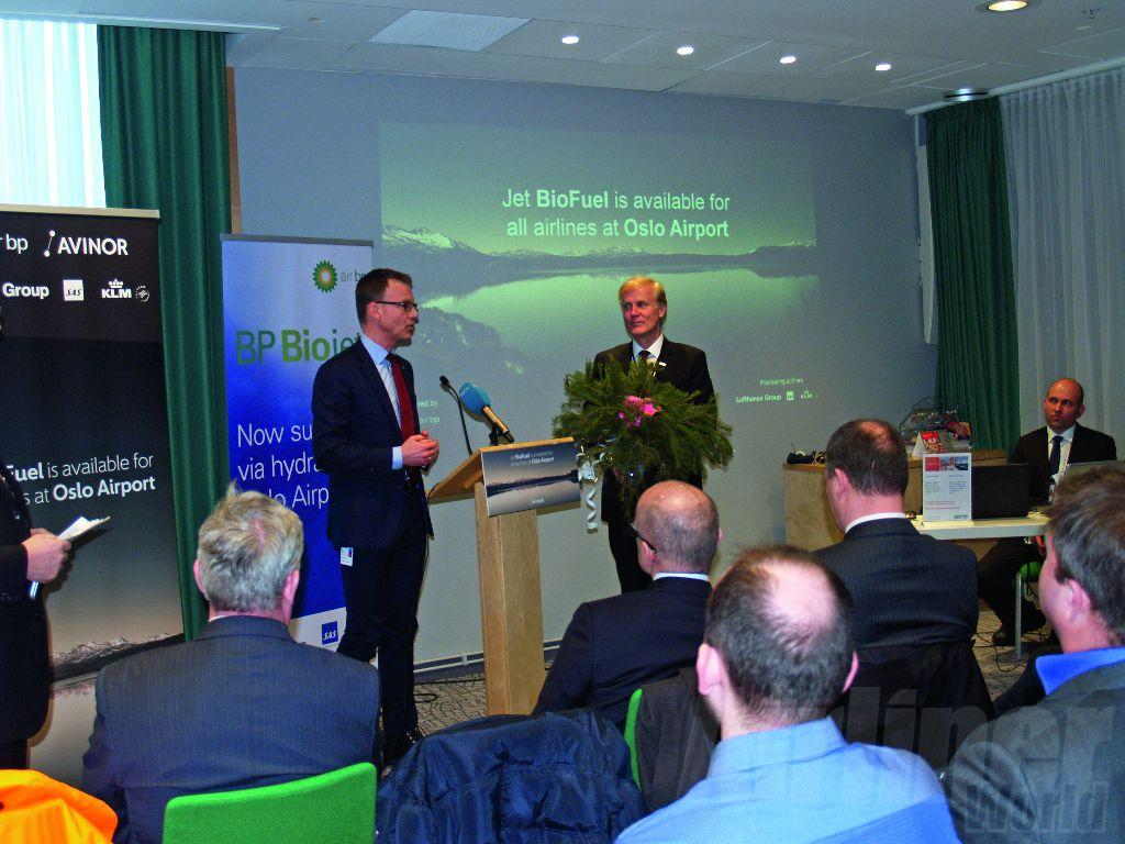 Avionor CEO, Dag Falk-Petersen (right) is presented with a branch from a Norway pine.