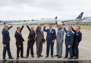 Saudi Arabian Airlines and Airbus officials celebrate the handover of the carrier's first A330-300 Regional. (Airbus)