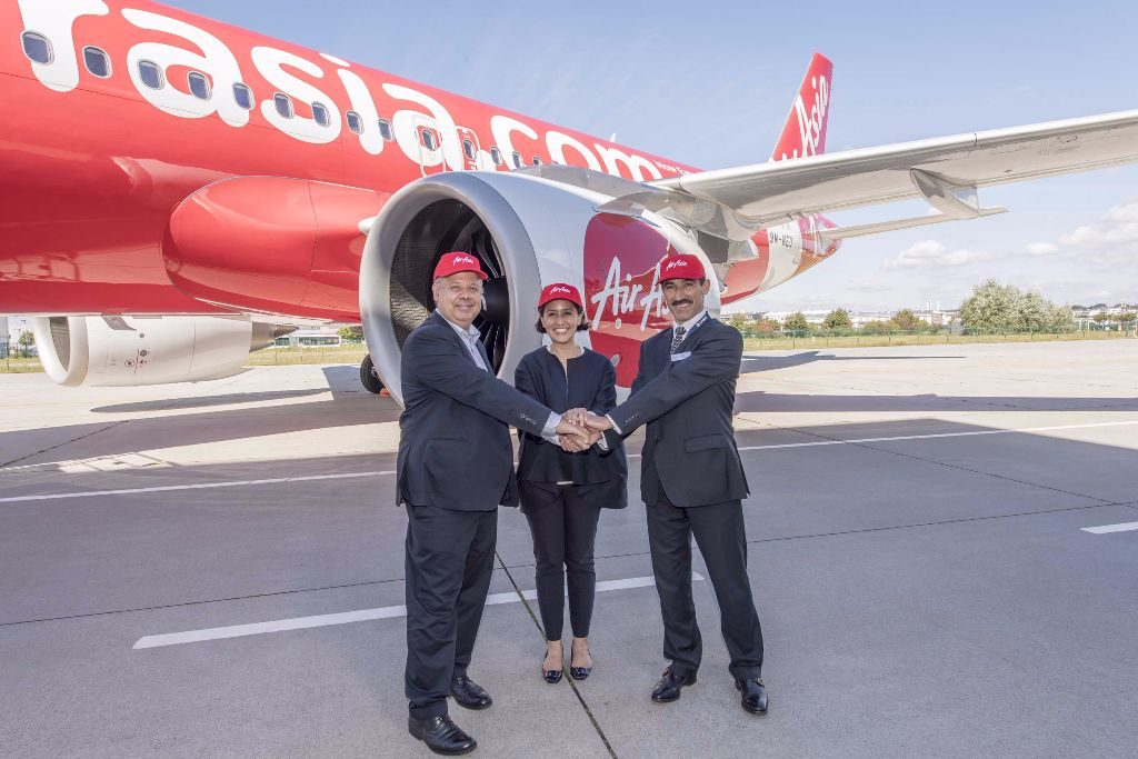 AirAsia bosses celebrate the handover of the airline's first A320neo. Airbus
